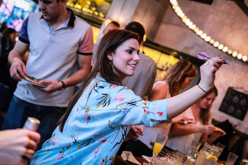 An image of a girl preparing to throw a dart at Flight Club in Shoreditch